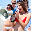 Young group with megaphone — Stockfoto