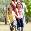 Happy family having fun in the park — Stock Photo
