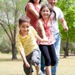 Happy family having fun in the park — Stock Photo