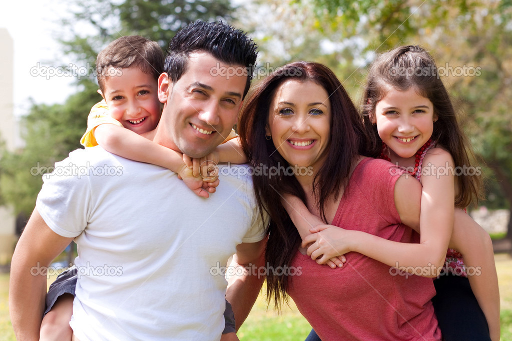 Caucasian Parents carrying their kids in the park,outdoor — Stock Photo #3040738