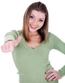 Smiling girl showing her thumps up — Stock Photo
