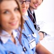 Hospital staff sitting in a row — Stock Photo