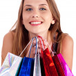Woman holding lots of shopping bags — Stock Photo