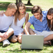 Young boys and girl students from laptop — Stock Photo