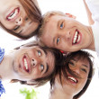 Stock Photo: Circle of happy friends heads togethe