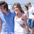 Happy young couples walking — Stockfoto