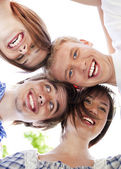 Circle of happy friends heads togethe — Stock Photo