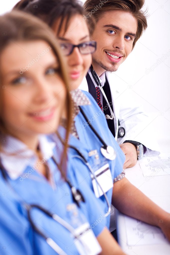 Hospital staff sitting in a row over white background — Stock Photo #3077758