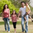 Family playing in the park — Stock Photo