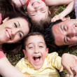Parents and kids lying on the floor — Stock Photo