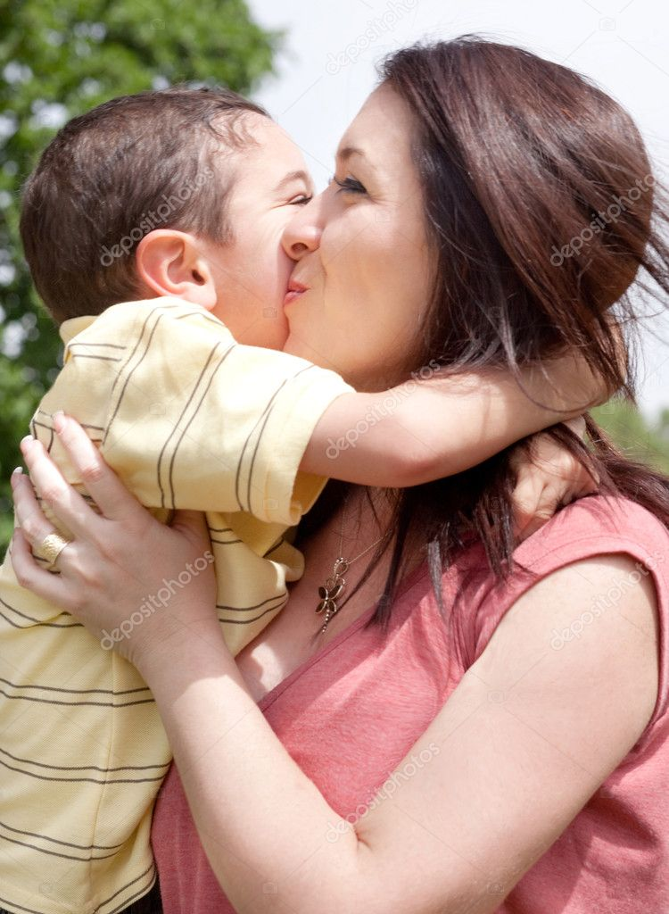 Children kissing his mom in the park, outdoor  Stock Photo #3122255
