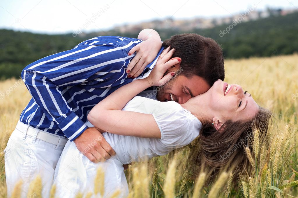 Men and woman hugging in the meadow — Stock Photo #3124281
