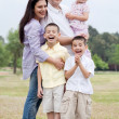Happy family in the park — Stock Photo #3136393