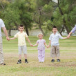 Happy family holding hands — Stock Photo #3136431
