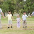 Happy family holding hands — Stock Photo
