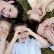 Happy family lying in the ground — Stock Photo #3136477