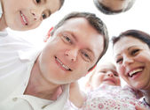 Happy family from down view — Stock Photo
