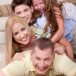 Stock Photo: Portrait of happy family Lying On Top