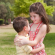 Stock Photo: Brother and sister affectionatly hugging