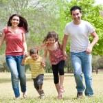 Family running on park — Stock Photo