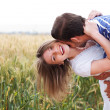 Happy young Couple hugging and kissing eachother — ストック写真