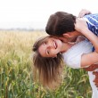 Happy young Couple hugging and kissing eachother — Stock Photo
