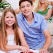 Happy young kids with gift boxes in living room — Stock Photo