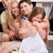 Happy family sitting in straight and having fun — Stock Photo #3309170