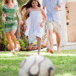Stock Photo: Happy family playing soccer and having fun