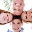 Happy family smiling and joining their heads together — Stock Photo