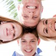 Stock Photo: Happy family smiling and joining their heads together
