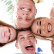 Happy family joining their heads together and moking fun - Stock Photo