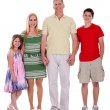 Happy family standing by holding their hands - Stock Photo