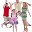 Stock Photo: Cheerful family jumping to the air and having fun