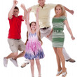 Foto Stock: Cheerful family jumping to the air and having fun