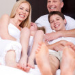 Loving family of four having fun and looking at you — Stock Photo