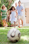 Happy family playing soccer and having fun — Stock Photo