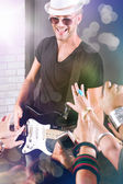 Guitarist performing for his adoring fans — Stock Photo