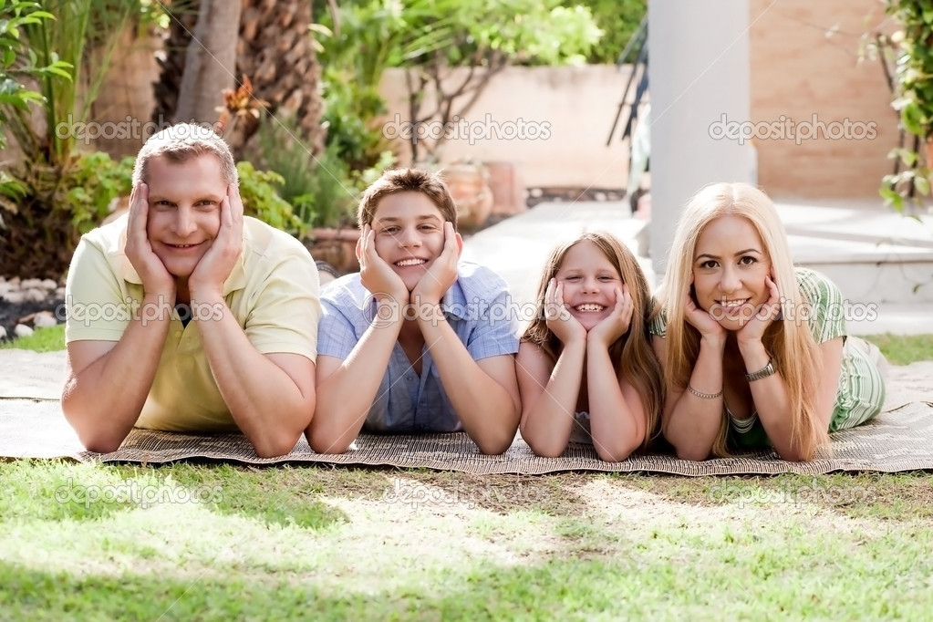 Lovely family on there backyard and looking at you    Stock Photo #3309195