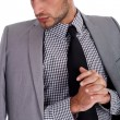 Serious business man with his half weared suit — Stock Photo