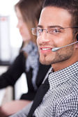 Business executive servicing the customer — Stock Photo