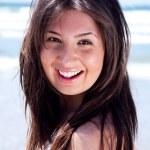 Close up shot of young beautiful woman looking at you — Stock Photo