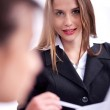 Cheerful young business woman in her meeting with her collegue — Stock Photo #3435911