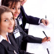 Closeup of attractive business woman with colleague — Stock Photo