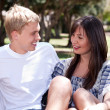 Young romantic couple sitting together and having fun — Stock Photo