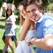 Young couples playing tug of war game and having fun — 图库照片
