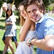 Young couples playing tug of war game and having fun — Stockfoto