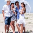 Romantic couples of four at the beach — Stock Photo #3436107