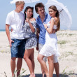 Romantic couples of four at the beach — Stockfoto #3436107