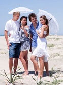 Romantic couples of four at the beach — Stock Photo